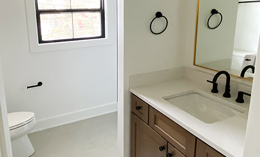 Light colored bathroom with vanity