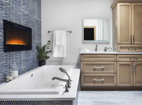 Large bathtub in elegant bathroom with electric fireplace